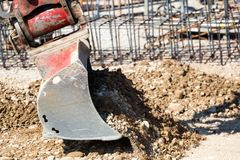 Rnu excavator construction site Stock Images