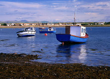 Roa island, Cumbria, England. The small bay at Roa island in Cumbria, showing various fishing boats at low tide Stock Photography