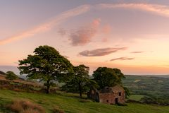 The Roaches as sunset lights the trees, and rocks at Roach End in the Peak District National Park, Staffordshire. UK stock image