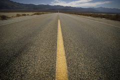 Road. Wide angle view af a road through the death valley Stock Images
