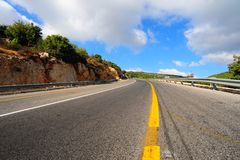Road. Empty Highway In North Galilee, Israel, Against Blue Sky Stock Photos
