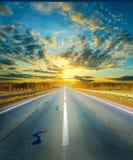Road. Sunset above empty asphalt road Stock Images