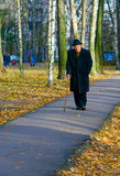 The Road. Portrait of walking old man in a hat with walkingstick Stock Image
