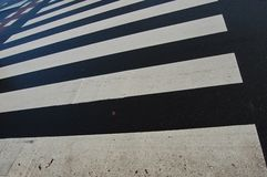 Road. A black zebra crossing with white stripes Royalty Free Stock Image