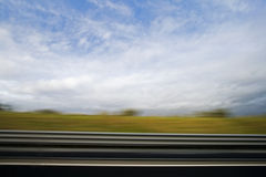 On the Road. Motion blurred panorama during a road trip Royalty Free Stock Photography