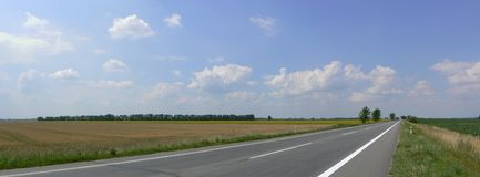Road. Empty asphalt road and blue sky Royalty Free Stock Image