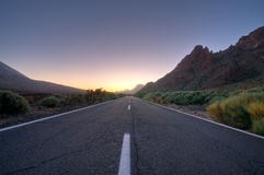 Road. A mountain road just before the sun looks up over the mountains Stock Image
