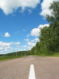 Road. About a wood, summer, clouds Royalty Free Stock Photography