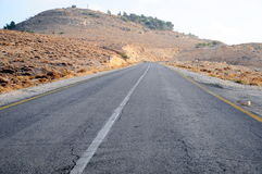 Road. Long empty road stretching out into the distance Stock Image