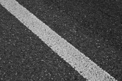 Road. Close -up of white line in the on the road Stock Photos