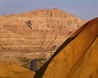 Road between. A distant road, as seen between the mountains of the badlands in badlands national park, south dakota royalty free stock photography