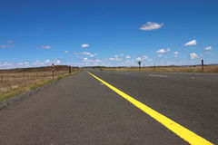 The road. The road to nowhere on a sunny summer day. Freshly painted lines on the tar Stock Photo