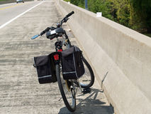 On the road. Bicycle parked on the side on the road on a bridge Stock Photo