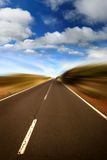 Road. Empty road, clouds. Motion blur Stock Image