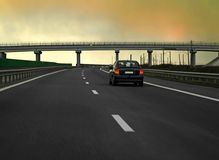 Road. Traveling with a car on sunset Royalty Free Stock Photo