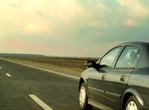 Road. Traveling with a car on sunset royalty free stock images