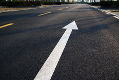 Road. Black road with white and yellow signs Royalty Free Stock Photo