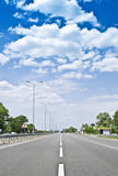 Road. Perfect road under the cloudy sky Royalty Free Stock Photo