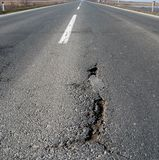 Road 21. Damaged asphalt road in close up Royalty Free Stock Image
