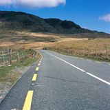 Road. The road curves up the mountain. Killarney Co Kerry Stock Photo