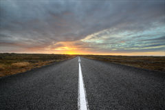 Road. Deserted road towards sunsets on Iceland Royalty Free Stock Images