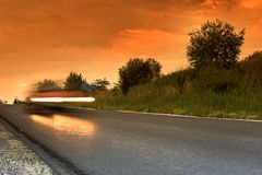 Road. On the road at sunset Royalty Free Stock Image