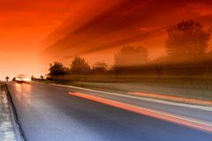Road. Lihgttracks over the highway by night Stock Photography