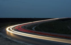 Road. Lihgttracks over the highway by night Royalty Free Stock Photos