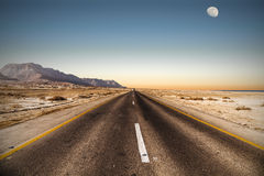 Road. In desert under the moon Royalty Free Stock Photography