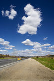 Road. Big white clouds over the road Royalty Free Stock Photo