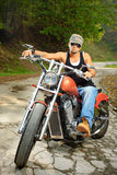 On the road. Young biker on a chopper Royalty Free Stock Photo