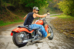 On the road. Young biker on a chopper Stock Photos