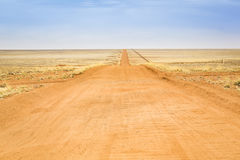 On the road. Dirt road to the horizon in Namibia, Southern Africa royalty free stock photo