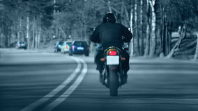 Road. Motorcycle rider on the road royalty free stock image