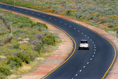 Road. A Car on a lonely road in South Africa Stock Image