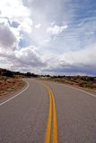 Road. A winding road going off into the sky Royalty Free Stock Photos