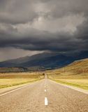 Road. Mountain landscape with road and cloudy sky Stock Images