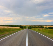 The Road. Leaves for limits of horizon Royalty Free Stock Photos