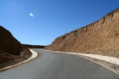 Road. Between mantains. where is the destination? what is the view on the other side of the Royalty Free Stock Photography