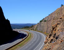 On the Road. Highway cut in mountain stock photos