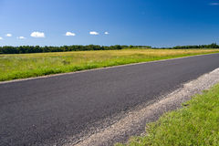 Road. A photo of landscape with road before the corn field Stock Image