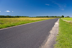 Road. A photo of landscape with road before the corn field Stock Photo