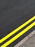 Road. Yellow no parking lines on road Royalty Free Stock Photo