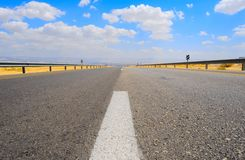 Road. Empty Highway in Desert Near Dead Sea, Israel, Against Blue Sky with Clouds Stock Images