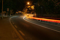 Road. A car passing in the night Royalty Free Stock Photos
