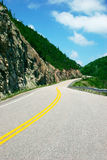 On the Road. This is the road going around the Cabot Trail in Cape Breton, Nova Scotia, Canada Royalty Free Stock Images