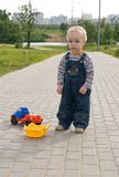 Road accident. Sad boy with a broken toy truck Stock Photography