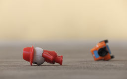 Road accident. Concept of road accident. Toy man and toy car fall on road. Traffic violation Royalty Free Stock Image
