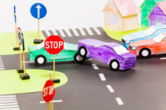 Road accident on a crossings at the toy city. Road accident on a crossings with two handmade paper cars at the toy city Royalty Free Stock Images