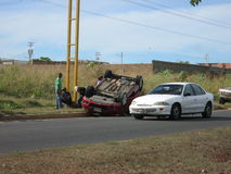 Road accident, flipped car. Road accident at a crossroads , a car was turned completely off the track. Traffic accidents are , in some countries , the leading royalty free stock image